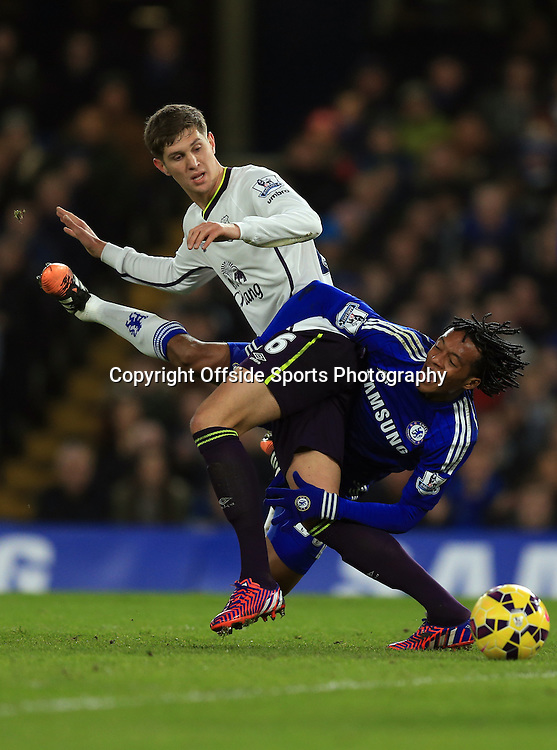 11 February 2015 - Barclays Premier League - Chelsea v Everton - Juan Cuadrado of Chelsea tangles with John Stones of Everton - Photo: Marc Atkins / Offside.
