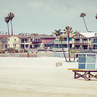 Seal Beach California coastline retro panorama photo with the beach, lifeguard tower, and oceanfront homes. Seal Beach is in Orange County Southern California in the United States of America. Panoramic photo ratio is 1:3.