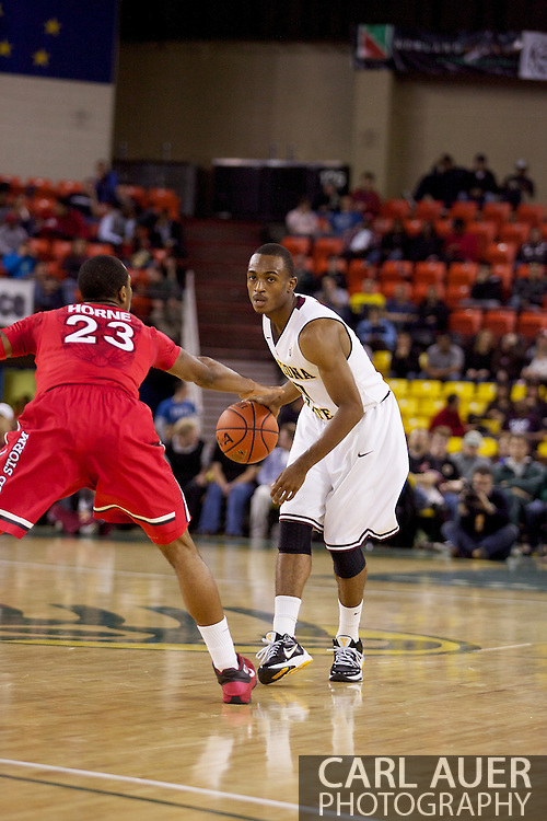 November 27th, 2010:  Anchorage, Alaska - Arizona State's Jamelle McMillan (10) runs the offense in the Sun Devil's 58-67 loss to St. John's in the championship game of the Great Alaska Shootout.  McMillan is the son of former NBA Seattle Super Sonics player and current Portland Trailblazer's coach Nate McMillan.