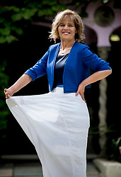 EMBARGOED TO 14:00 TUESDAY 16 MAY.<br /> Tracey Topping, 47, from Northampton, holds her old trousers during a photo call at the Roof Gardens in Kensington, London, after being announced as Slimming World's Greatest Loser 2017 following a weight loss of 18 stone and dropping from a 34/36 to 10/12 dress size.
