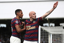 Newcastle United's Jonjo Shelvey (right) celebrates scoring his side's opening goal with team mate Newcastle United's Isaac Hayden (left)during the Premier League match at Craven Cottage, London.