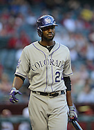 PHOENIX, AZ - APRIL 26:  Dexter Fowler #24 of the Colorado Rockies reacts at bat in the game against the Arizona Diamondbacks at Chase Field on April 26, 2013 in Phoenix, Arizona.  The Rockies defeated the Diamondbacks 6 to 3.  (Photo by Jennifer Stewart/Getty Images)
