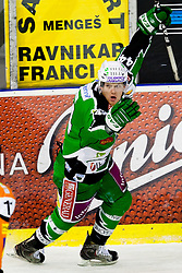 Jamie Fraser (HDD Tilia Olimpija, #44) celebrates scoring a goal during ice-hockey match between HDD Tilia Olimpija and Moser Medical Graz 99ers in 42nd Round of EBEL league, on Januar 15, 2012 at Hala Tivoli, Ljubljana, Slovenia. HDD Tilia Olimpija defeated Moser Medical Graz 99ers 4:2. (Photo By Matic Klansek Velej / Sportida)