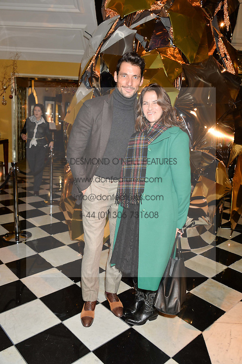 DAVID GANDY and TRACEY EMIN at a party to celebrate theunveiling of the Claridge's Christmas Tree designed by Christopher Bailey for Burberryheld at Claridge's, Brook Street, London on 18th November 2015.