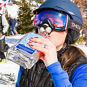 A skier drinking Ullr wearing a cat nose.