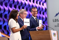 LIMA, Sept. 14, 2017  International Olympic Committee President Thomas Bach (C) passes two cards to Anne Hidalgo, Mayor of Paris, and Eric Garcetti, Mayor of Los Angeles, during the presentation and announcement ceremony of the 2024 and 2028 Summer Olympic Games at the 131st IOC session in Lima, Peru, on Sept. 13, 2017. The IOC makes historic decision by simultaneously awarding Olympic Games 2024 to Paris and 2028 to Los Angeles on wednesday. (Credit Image: © Li Ming/Xinhua via ZUMA Wire)
