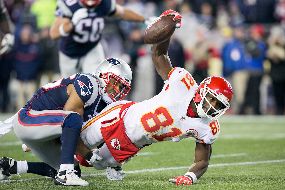 Kansas City Chiefs wide receiver Jason Avant (81) reaches for extra yardage as he is tackled by New England Patriots cornerback Logan Ryan (26) in the fourth quarter of the AFC Divisional Playoff game at Gillette Stadium in Foxborough, Massachusetts on January 16, 2016. The Patriots defeated the Chiefs, 27-20.    Photo by Kelvin Ma/ UPI