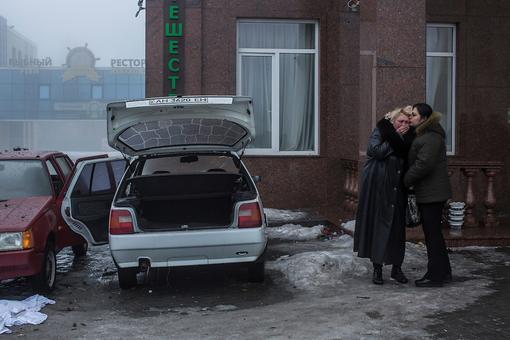DONETSK, UKRAINE - JANUARY 30, 2015: A woman cries at the scene of a rocket attack that killed at least five people near a humanitarian aid distribution center in Donetsk, Ukraine. At least two others died in a separate shelling nearby. CREDIT: Brendan Hoffman for The New York Times
