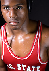 "25 February 2007:  Jalil Dozier..Wrestler of North Carolina State Wolfpack..Born 11/22/1986; Age 20 when photos were taken...5'7"" and 160 lbs. ..Photo taken his sophomore year..From Fayetteville, NC / Jack Britt HS..High School:.Finished third at 119 pounds in the North Carolina 4-A state tournament as a senior, compiling a 56-6 record at 112 and 119 pounds ? Went 57-7 as a junior and took fourth place in the state tournament ? Completed his high school career with a 140-26 record."