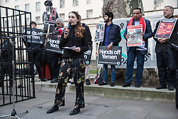London, UK. 26th March, 2019. Hannah Phillips of the Arab Organisation for Human Rights addresses human rights campaigners from several different groups including Stop The War Coalition and Campaign Against the Arms Trade protesting opposite Downing Street against British arms sales to Saudi Arabia used to wage a 4-year war in Yemen. According to charity Save The Children, an estimated 85,000 children under the age of five may have died from acute malnutrition since the war began in 2015 and 14 million Yemenis are believed to face the risk of famine; according to the United Nations, millions of citizens have been displaced, over 56,000 Yemenis have been killed and the country is facing the 'world's worst humanitarian crisis'.