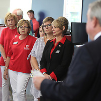 Employees with First American National Bank listen as CEO Tommy Chamblee addresses those in attendence for the ribbon cutting of the new branch on North Gloster Street in Tupelo on Friday afternoon.
