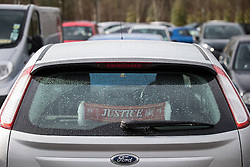 "© Licensed to London News Pictures . 12/02/2016 . Warrington , UK . A Hillsborough "" JUSTICE "" scarf hung in the rear windscreen of a car parked outside the Hillsborough Inquest at Birchwood Park in Warrington today (12th February 2016) . Photo credit : Joel Goodman/LNP"