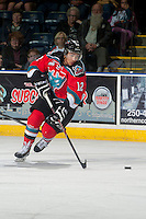 KELOWNA, CANADA - OCTOBER 11: Tyrell Goulbourne #12 of Kelowna Rockets skates with the puck against the Lethbridge Hurricanes on October 11, 2014 at Prospera Place in Kelowna, British Columbia, Canada.   (Photo by Marissa Baecker/Shoot the Breeze)  *** Local Caption *** Tyrell Goulbourne;