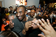 Kobe Bryant makes his way through the crowd at the Nike Town in Beverly Hills for the launch of his Zoom Kobe 1 shoe Friday February 10, 2006. Several hundred people were unable to get inside.