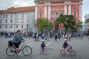 Young cyclists in Presernov Square in the Slovenian capital, Ljubljana, on 25th June 2018, in Ljubljana, Slovenia. Ljubljana is a small city with flat terrain and a good cycling infrastructure. It was featured at eighth on the 'Copenhagenize' index listing the most bike-friendly cities in the world.