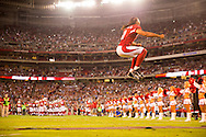 Arizona Cardinals wide receiver Larry Fitzgerald (11) walks out of the tunnel and jumps up in the air on the field  before an NFL football game between the Arizona Cardinals and the San Diego Chargers , Monday, Sept. 8, 2014, in Glendale, Ariz. (AP Photo/Tom Hauck)