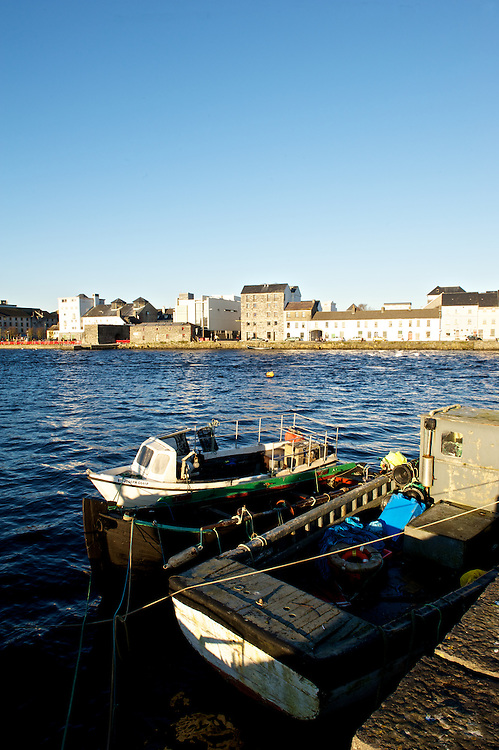 Fishing boats at rest along the Quays in Galway, Ireland.