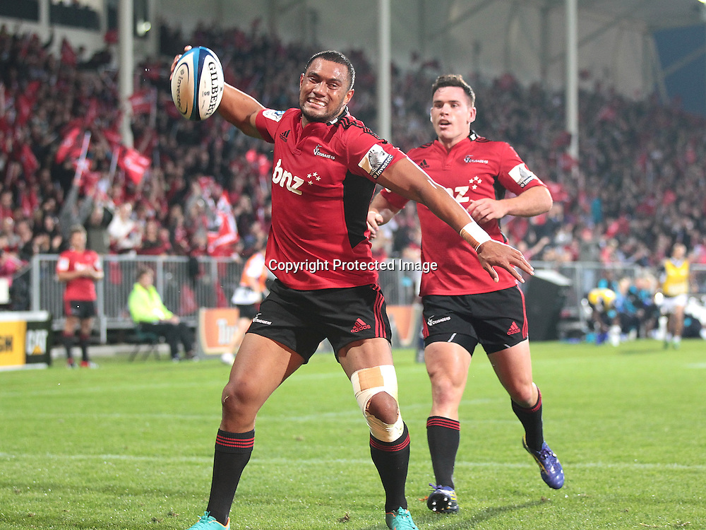Robbie Fruean of the Crusaders celebrates scoring a try during the Super Rugby match between the Crusaders and the Bulls at AMI Stadium on Saturday March 15, 2013 in Christchurch, New Zealand. Photo: Martin Hunter/Photosport