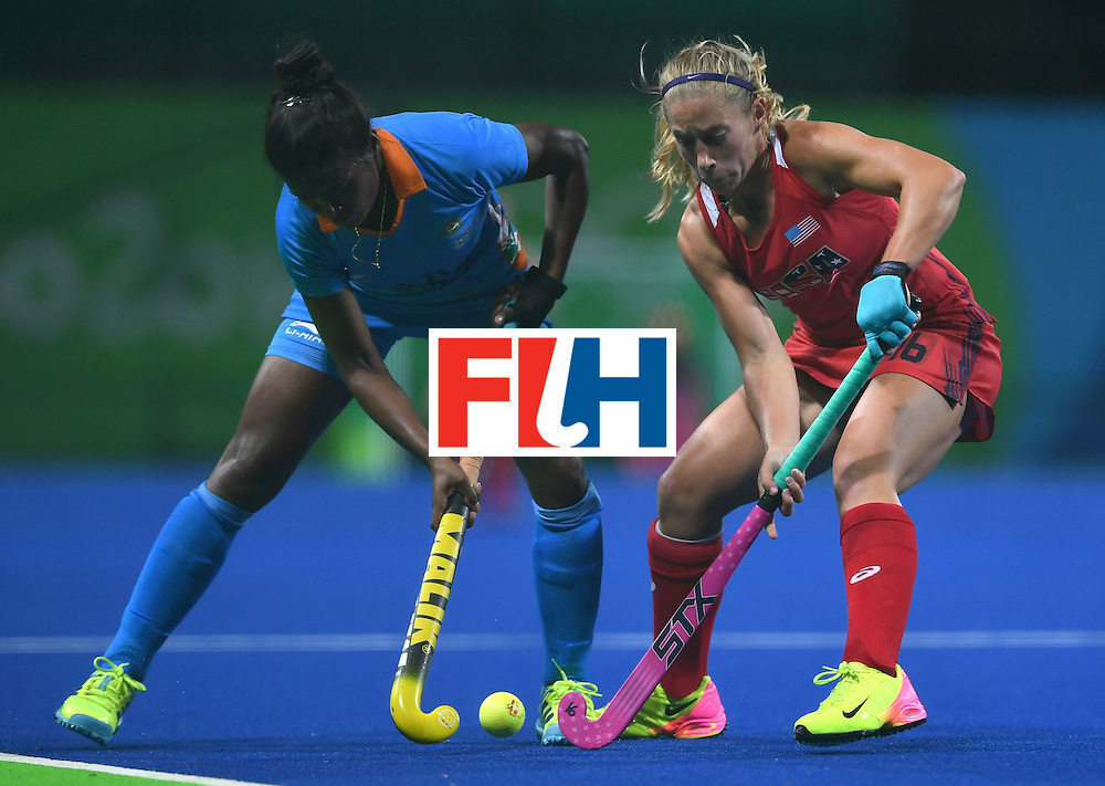 The USA's Katie Bam (R) vies for the ball with India's Sunita Lakra during the women's field hockey USA vs India match of the Rio 2016 Olympics Games at the Olympic Hockey Centre in Rio de Janeiro on August, 11 2016. / AFP / MANAN VATSYAYANA        (Photo credit should read MANAN VATSYAYANA/AFP/Getty Images)