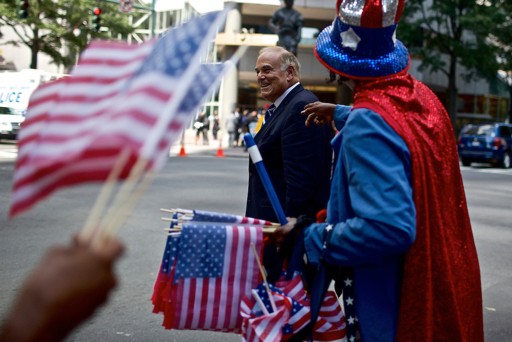 Vendors try to sell merchandise in Charlotte, NC during the 2012 Democratic National Convention on Sept. 5, 2012.