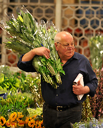 © Licensed to London News Pictures. 15/03/2012. London, UK. A wholesaler prepares an order. The Mothering Sunday sales rush is on for flower growers, suppliers, florists and retailers amongst the Flowers at the New Covent Garden Flower Market on March 15th 2012 in London, England. New Covent Garden Flower Market is London's premier wholesale market stocking the widest range of flowers, plants and foliage in the UK. The run up to Mothers' Day is crucial in the flower selling calendar as Mothers' Day sales are condensed into about four days making the market very busy. Traditionally, Mothering Sunday was a day when children, mainly daughters, who had gone to work as domestic servants, were given a day off to visit their mother and family. Today, Mother's Day is a time when children give flowers and cards to their mothers, and generally pamper them..  Photo credit : Stephen SImpson/LNP