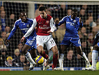 Photo: Olly Greenwood.<br />Chelsea v Arsenal. The Barclays Premiership. 10/12/2006. Arsenal's Robin Van Persie surrounded by Chelsea's Claude Makelele and Michael Essien