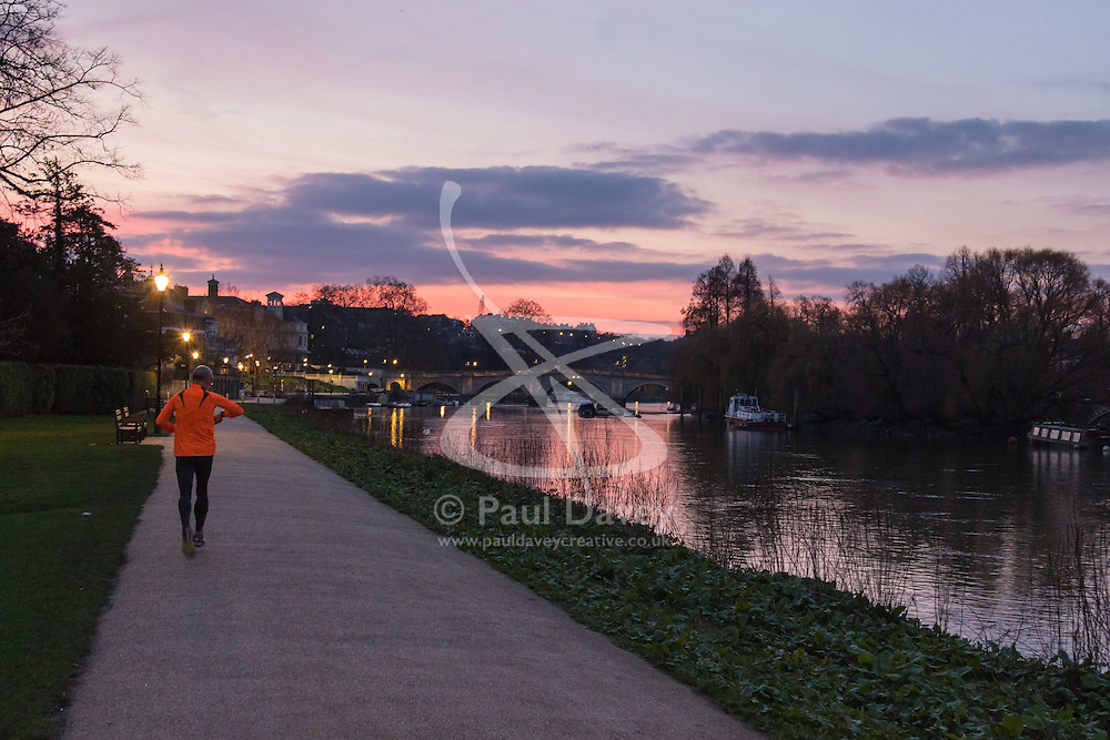Richmond, London, February 17th 2016. A runner  jogs along the towpath as dawn breaks over the River Thames. <br /> ///FOR LICENCING CONTACT: paul@pauldaveycreative.co.uk TEL:+44 (0) 7966 016 296 or +44 (0) 20 8969 6875. ©2015 Paul R Davey. All rights reserved.