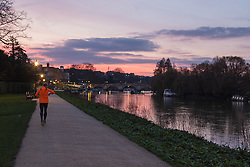 Richmond, London, February 17th 2016. A runner  jogs along the towpath as dawn breaks over the River Thames. <br /> ///FOR LICENCING CONTACT: paul@pauldaveycreative.co.uk TEL:+44 (0) 7966 016 296 or +44 (0) 20 8969 6875. &copy;2015 Paul R Davey. All rights reserved.