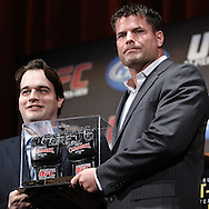 "NEW YORK, NEW YORK, MARCH 24, 2010: UFC middleweight fighter Brian Stann (right) poses for photographs with the Tequila Cazadores Authentic Spirit Culmination award, which included a $10,000 check for his charity, Hire Heroes, during the pre-fight press conference for ""UFC 111: St. Pierre vs. Hardy"" inside Radio City Music Hall in New York City"