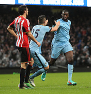 Yaya Toure of Manchester City celebrates with Stevan Jovetic after scoring the first goal against Sunderland during the Barclays Premier League match at the Etihad Stadium, Manchester.<br /> Picture by Michael Sedgwick/Focus Images Ltd +44 7900 363072<br /> 01/01/2015