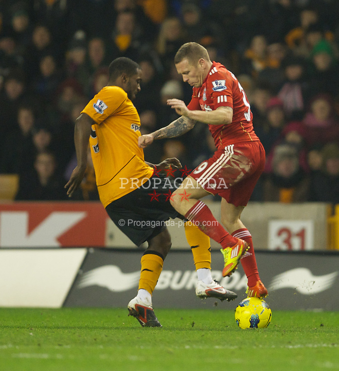 WOLVERHAMPTON, ENGLAND - Tuesday, January 31, 2012: Liverpool's Craig Bellamy in action against Wolverhampton Wanderers's Emmanuel Frimpong during the Premiership match at Molineux. (Pic by David Rawcliffe/Propaganda)