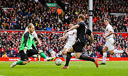 Fernando Torres has his shot saved by Peter Gulacsi - Photo mandatory by-line: Dougie Allward/JMP - Mobile: 07966 386802 - 29/03/2015 - SPORT - Football - Liverpool - Anfield Stadium - Gerrard's Squad v Carragher's Squad - Liverpool FC All stars Game
