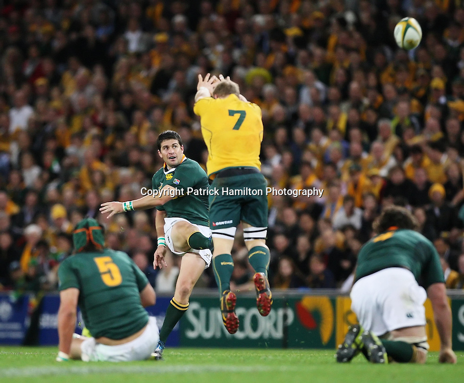 David Pocock (r) leaps to charge down a drop goal attempt by Morne Steyn during the Tri-Nations rugby Test at Suncorp Stadium in Brisbane,  July 24, 2010. The All Blacks again ran the world champion Springboks into submission to win the second Tri-nations rugby Test 31-17 with another four-try bonus point performance. Photo: Patrick Hamilton/Photosport