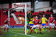 Rhys Taylor of Wrexham on loan from Newport County punches clear under pressure from Tyrone Williams during the Vanarama National League match between Wrexham AFC and Kidderminster Harriers at the Glyndŵr University Racecourse Stadium, Wrexham, United Kingdom on 23 February 2016. Photo by Mike Sheridan.