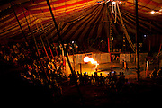 Islamabad: A flame thrower with the Jan Baz Circus prepares for an evenings entertainment at Pothohari Village in Islamabad.