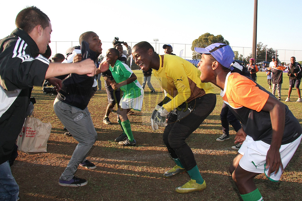 School of Excellence celebrate after beating Orlando Pirates on penalties to win the Engen Knock Out Challenge during the final day of the Engen Knock Out Challenge held at Marks Park, Emmarentia  in Johannesburg on the 9th September 2012..Photo by Shaun Roy/ SPORTZPICS..