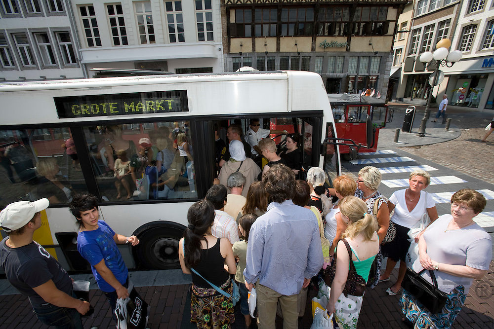 HASSELT - BELGIUM - 02 JULY 2008 --  The city of Hasselt has introduced a free public transport service since 1. July 1997. Here people boarding the Centrumpendel bus at the Grote Markt (Town square. Photo: Erik Luntang..