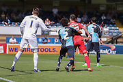 Reece Thompson being held by Sido Jombati during the Sky Bet League 2 match between Wycombe Wanderers and York City at Adams Park, High Wycombe, England on 8 August 2015. Photo by Simon Davies.