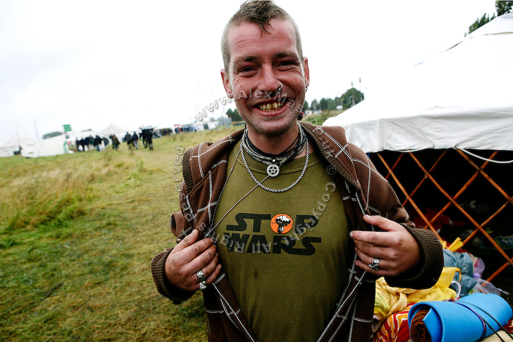 Climate change activists are challenging the weather, and the authorities, by setting up a seven-day-long camp 800 meters from Heathrow airport to protest against climate change and the expansion plans for the airport on Tuesday, Aug. 14, 2007, in Hayes and Harlington, England. Aviation is the fastest growing source of greenhouse gas emissions in the UK, and all our efforts to tackle climate change in other sectors are undone by the massive growth in air travel. Holding the camp at Heathrow aims to highlight the paradoxical government's airport expansion plans, target industry giants profiteering from the climate crisis, and raise awareness about the need to fly less. The camp also support local residents in their long-term struggle against the building of a third runway and the destruction of their communities. Heathrow, the world's busiest international airport, has been the target of Climat Camp campaing in 2007. www.climatecamp.org.uk  **Italy Out**..