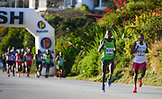 MOSSEL BAY, SOUTH AFRICA - SEPTEMBER 24: Vincent Kipchirchir (912) of Kenya and a runner from Hout Bay athletic club during the PetroSA Marathon finishing at Santos Caravan Park on September 24, 2016 in Mossel Bay, South Africa. (Photo by Roger Sedres/Gallo Images)