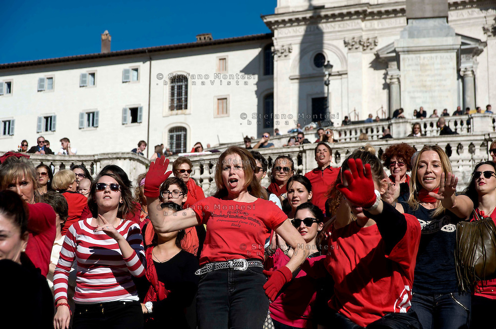 Roma 14 Febbraio 2014<br /> Flash mob mondiale One Billion Rising, Hands off Women, contro la violenza sulle donne, a Trinità dei Monti.<br />  Participants of the One Billion Rising movement stage a flashmob dance at the piazza Trinit dei Monti in a bid to highlight and call for an end to violence towards women.