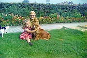 sisters posing with dog rural Holland 1960s