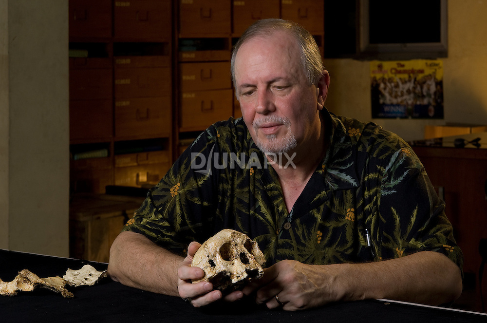 "Dr. William Jungers admires ""LB1"", the type specimen skeleton of Homo floresiensis, a.k.a., the Flores hobbit."
