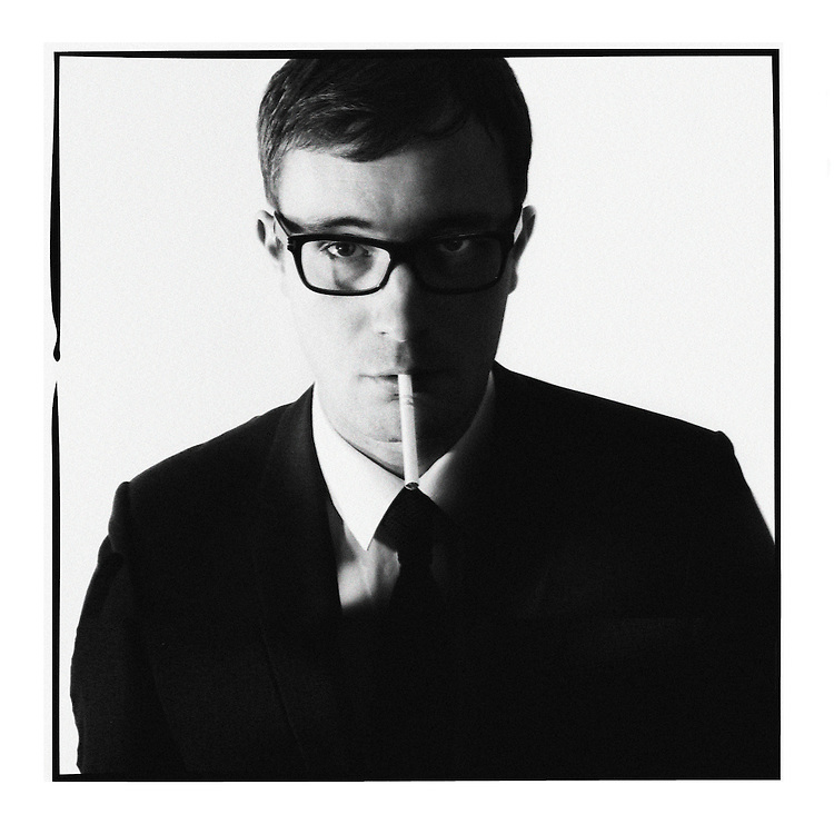 I have loved this iconic image for a long time! David Bailey's shot of Michael Caine as Harry Palmer used as promotional material for the IPCRESS File (1965). The harsh shadows which give the image a sense of retro urban cool so I tried to copy it myself. The model is a guy I work with, Kieran, who happens to be the biggest film buff like myself which really helped get into the mood. We had also just been to see &ldquo;Tinker Tailer Soldier Spy&rdquo;. I was really surprised by the awkward position Kieran had to stand in to get the cigarette tip to touch the right position on the collar of the shirt. It was a bit bum against the wall, stoop forwards, head down a bit, turn head a smidgen to the left, cigarette butt 2mm to the right... the things you do for art! This image has been mimic&rsquo;d so many times but, in my view, many of them not very well as the<br /> cigarette is totally in the wrong place. If you are trying to copy something do it well or not at all?