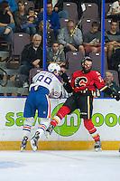 PENTICTON, CANADA - SEPTEMBER 17: Kayle Doetzel #89 of Edmonton Oilers checks Hunter Smith #71 of Calgary Flames on September 17, 2016 at the South Okanagan Event Centre in Penticton, British Columbia, Canada.  (Photo by Marissa Baecker/Shoot the Breeze)  *** Local Caption *** Kayle Doetzel; Hunter Smith;