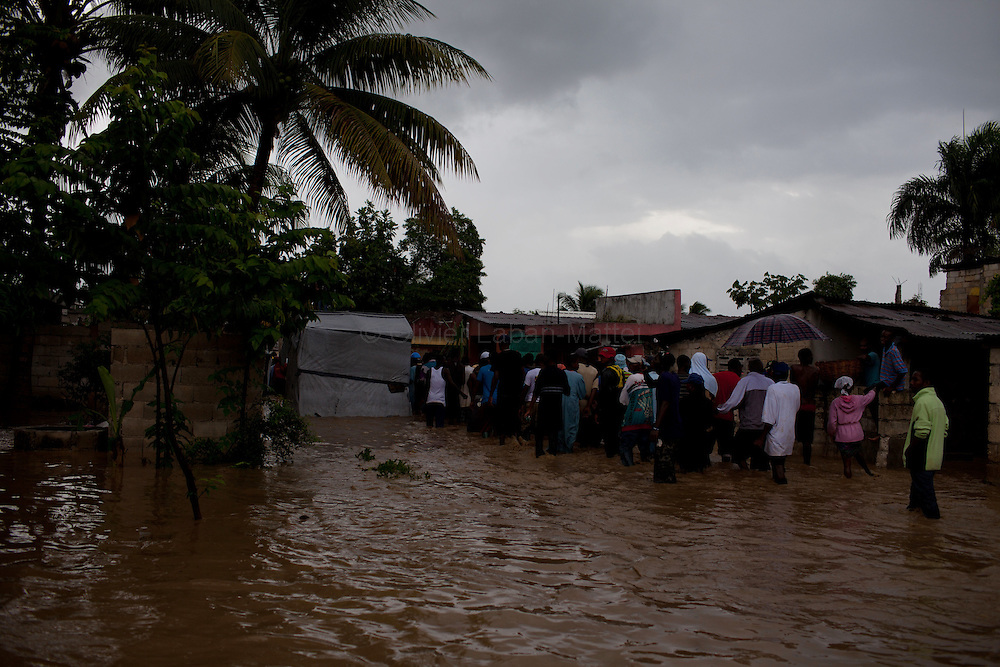 After hurricane Tomas went through Haiti, the city of Leogane has been totally flooded by the heavy rain and the overflow of the river Roullorne.///Haitians demonstrate in the the muddy water, in a street of Leogane during hurricane Tomas, to protest against the lack of help from the local authorities and the NGOs.