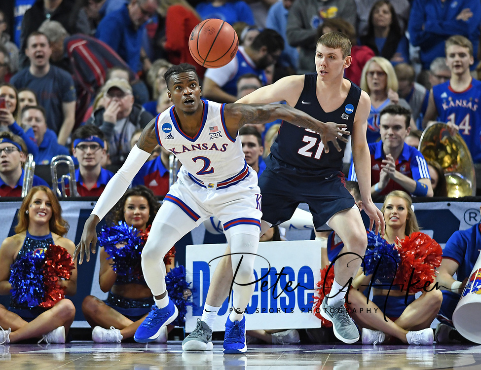 Kansas Jayhawks guard Lagerald Vick (2) battles for the ball with Pennsylvania Quakers guard Ryan Betley (21) during the first half in the first round of the 2018 NCAA Tournament at INTRUST Bank Arena.