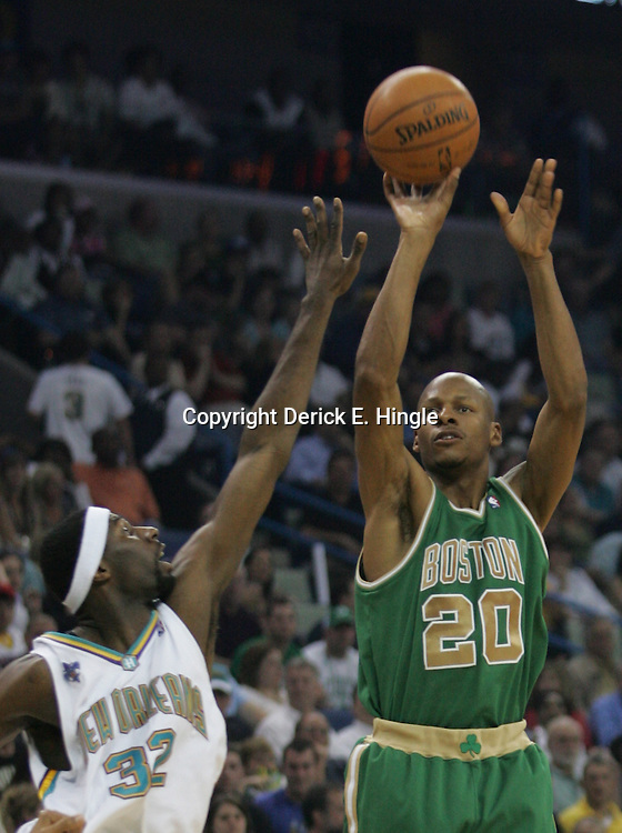 Ray Allen #20 of the Boston Celtics shoots over New Orleans Hornets forward Julian Wright #32  in the second quarter of their NBA game on March 22, 2008 at the New Orleans Arena in New Orleans, Louisiana. The New Orleans Hornets defeated the Boston Celtics 113-106.