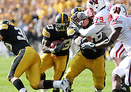 18 OCTOBER 2008: Iowa running back Shonn Greene (23) looks for a hole in the first half of an NCAA college football game against Wisconsin, at Kinnick Stadium in Iowa City, Iowa on Saturday Oct. 18, 2008. Iowa won 38-16.