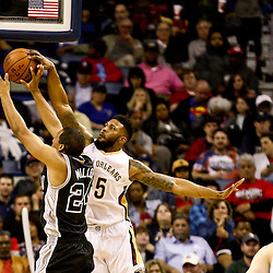 Mar 3, 2016; New Orleans, LA, USA; New Orleans Pelicans forward Alonzo Gee (15) blocks a shot by San Antonio Spurs guard Andre Miller (24) during the second quarter of a game at the Smoothie King Center. Mandatory Credit: Derick E. Hingle-USA TODAY Sports